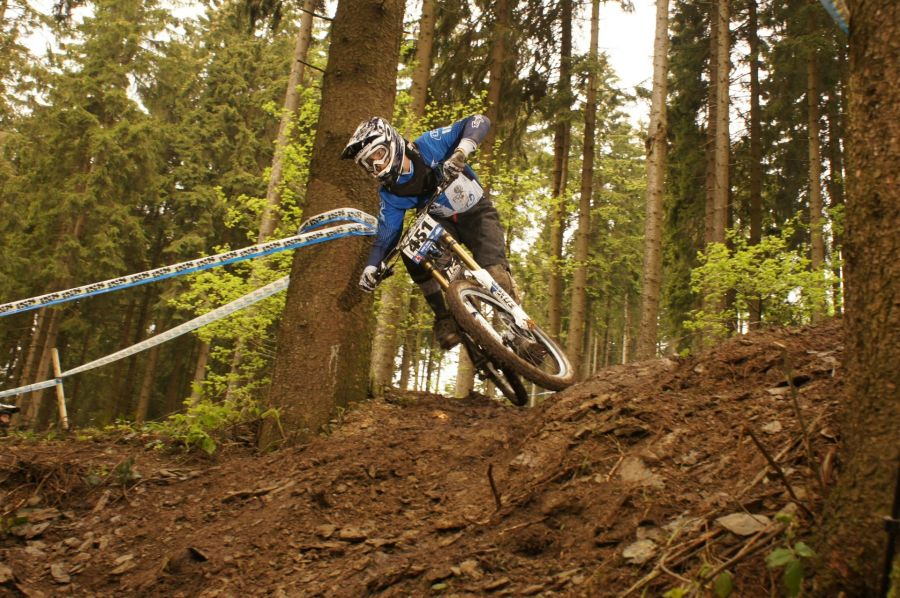 Racer on the competition of the mountain bike