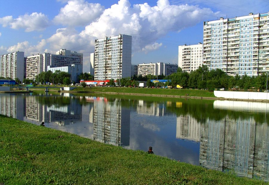 Moscow urban cityscape with buildings and pond