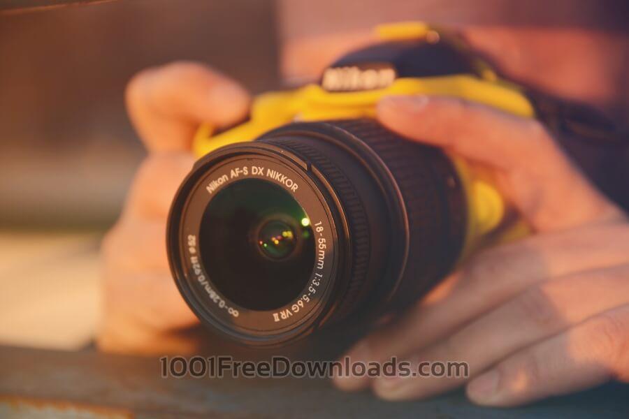 Free Photos: Man using a dslr camera | Abstract