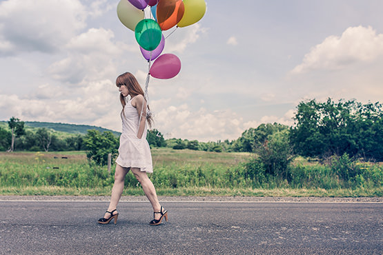 Free Young woman with balloons