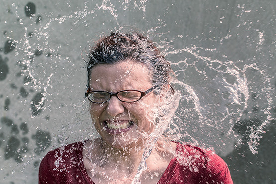 Free Woman splashed in the face with water