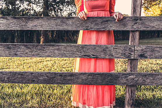 Free Woman in red dress near a fence