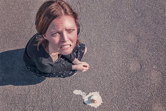 Free Dropped ice cream and sad woman
