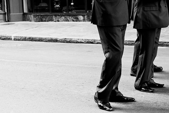 Free Men in suits on the street