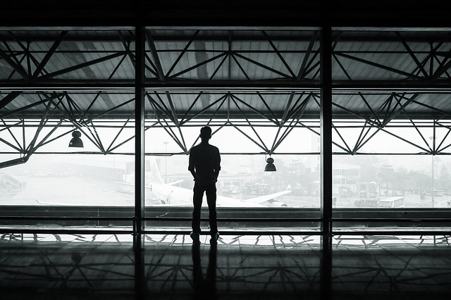 Free airport passenger waiting man standing