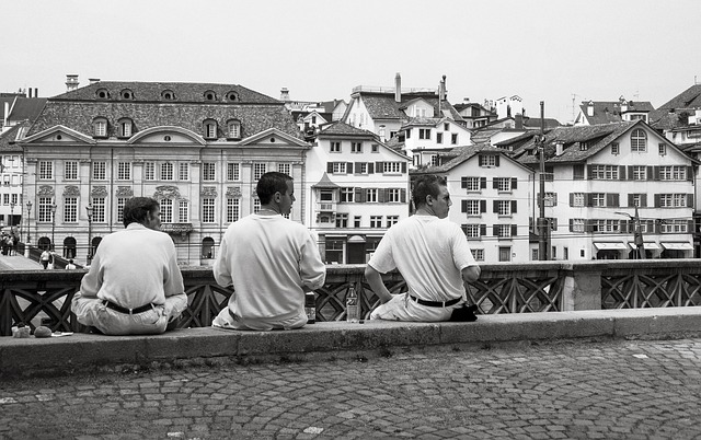 Free men sitting waiting wall urban city walkway