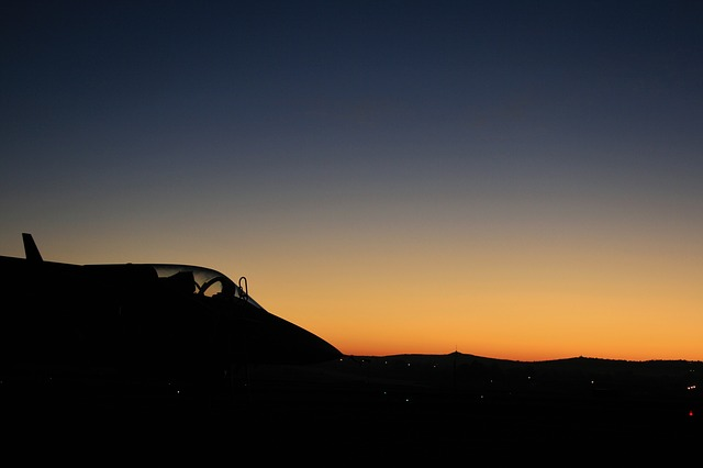 Free jet aircraft dawn sky glow fighter silhouette