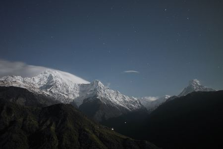 Free Night sky with stars over mountain covered with snow