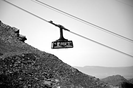 Free Cable car descends from the mountain