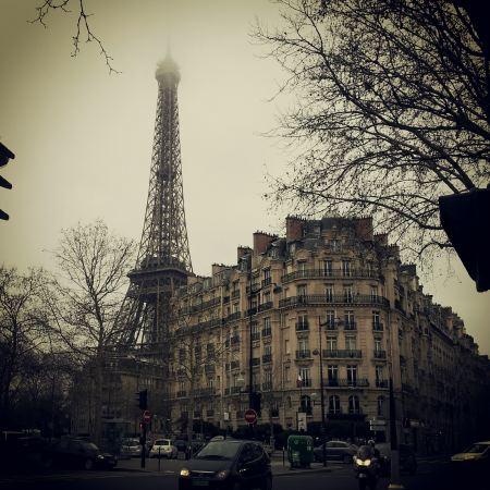 Free Eiffel Tower and a building in Paris