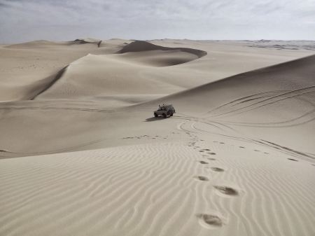 Free Jeep going through the desert