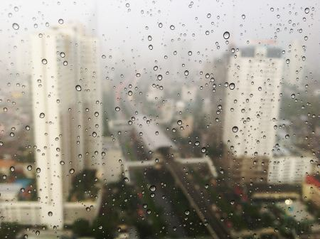 Free City view through raindrops of the window