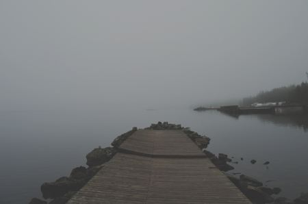 Free Old pier on a lake in the fog