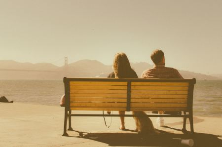 Free Couple sitting on bench