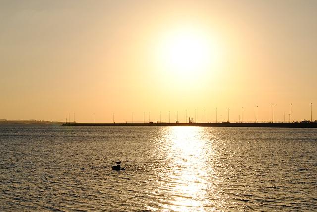 Free sunset of sun sky beach sea costa ocean clouds