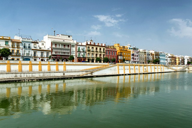 Free seville spain buildings canal river waterway