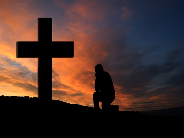 Free cross sunset silhouette man kneeling knee pray