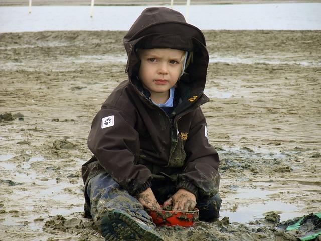 Free child north sea beach mud
