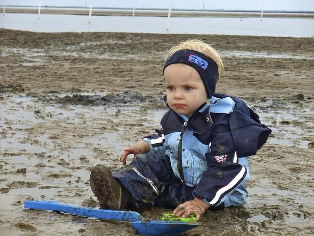Free child beach boy north sea mud