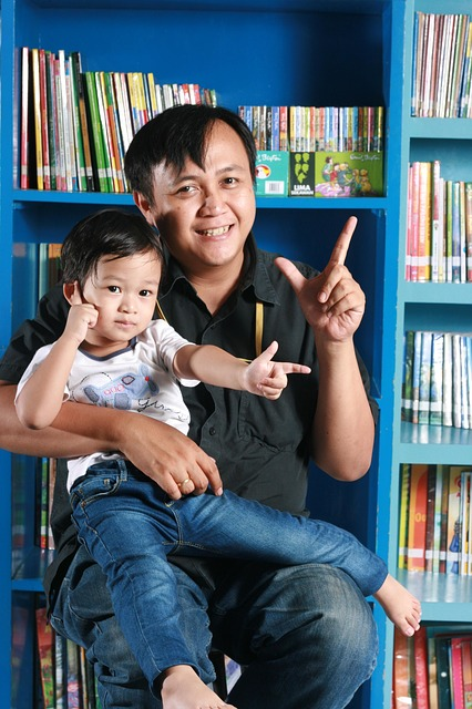 Free father son library happy kid sitting pose