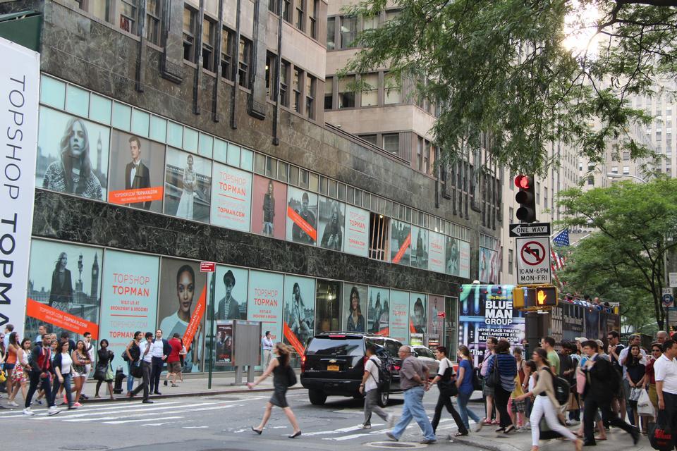 Free People walk along West Broadway