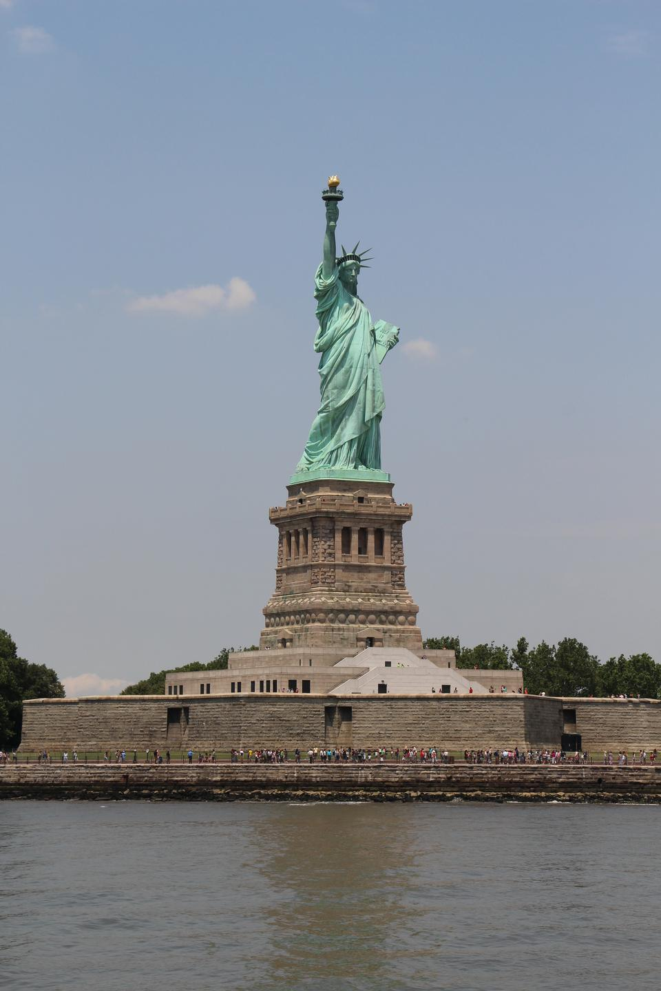Free Front view of Statue of Liberty with cloudy blue sky