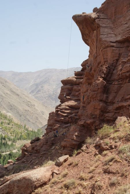 Free Young man climbing natural rocky wall