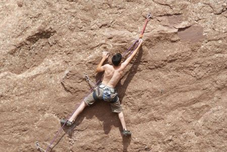 Free Young man climbing with wide valley