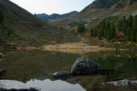 Free Alpine lake and Dolomiti mountains