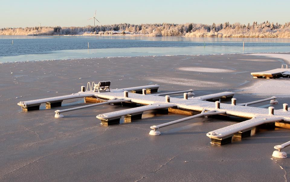 Free View of snow covered piers on frozen lake