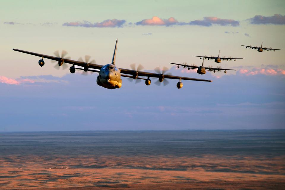 Free MC-130J Commando IIs conduct low-level formation training