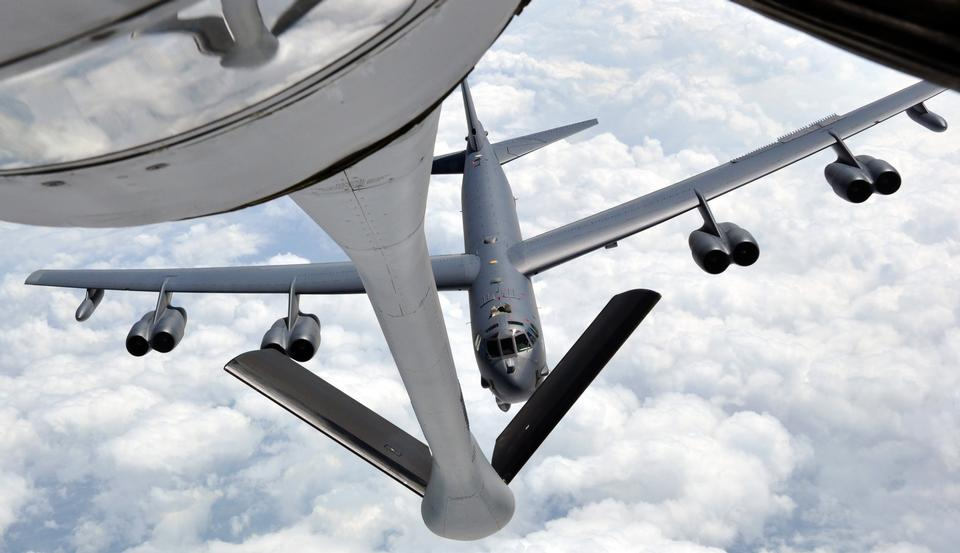 Free A B-52 Stratofortress approaches the refueling boom of a KC-135