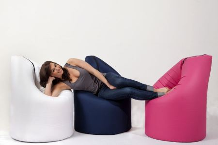 Free Attractive blonde woman  lying on the armchair