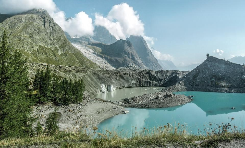 Free little morainic lake in Italian alps near Courmayeur, Italy