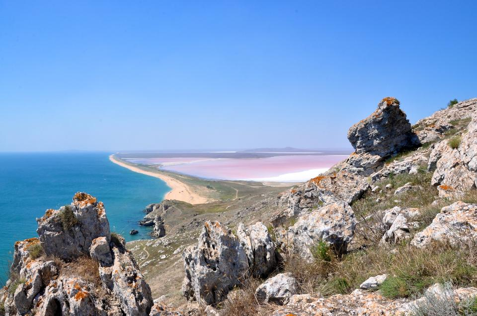 Free View from the mountains to the sea coast and mud pink lake