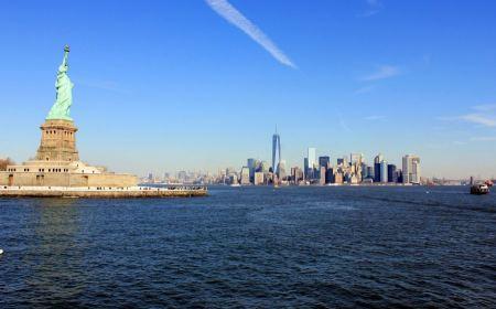 Free The landmark Statue of Liberty against the impressive New York