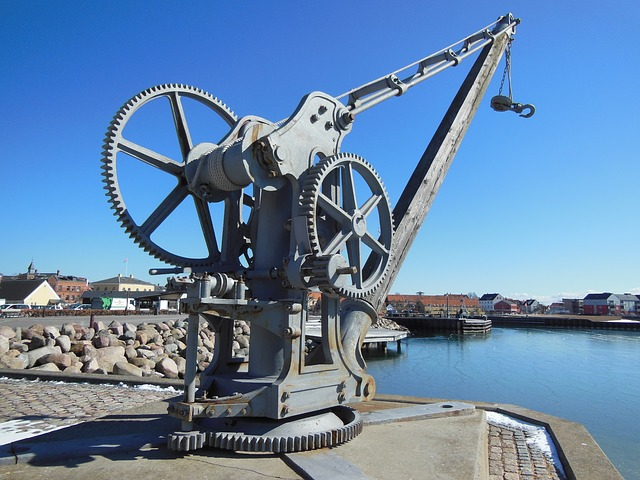 Free harbor old crane hoist gear metal gray crane quay
