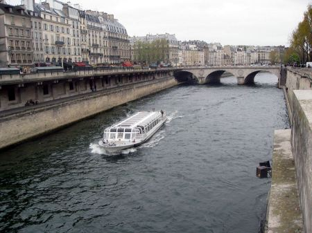 Free Paris, France. Touristic boat on the river