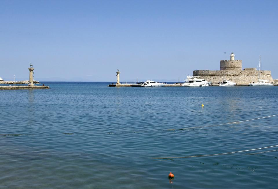 Free Panorama of Mandraki harbor and bronze deer statues