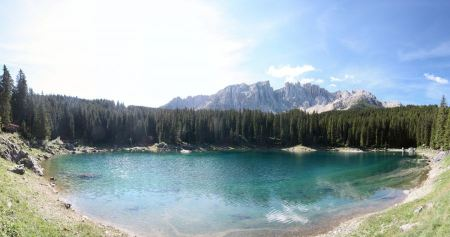 Free Carezza lake and Latemar in summer season with clouds, Dolomites