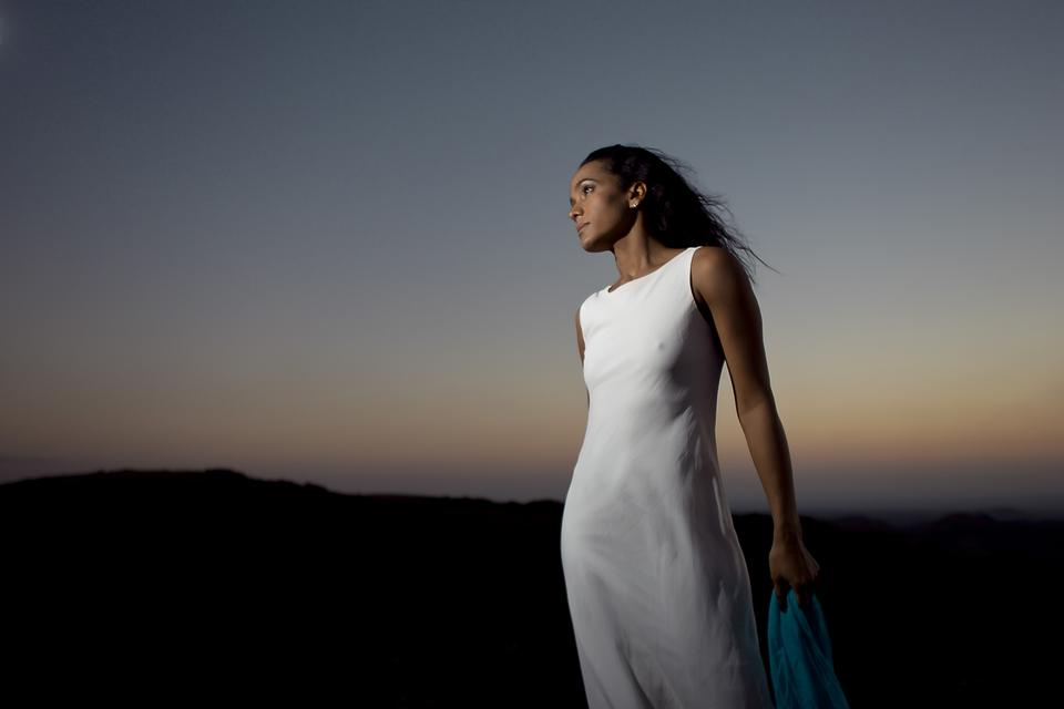 Free Beautiful young woman wearing elegant white dress