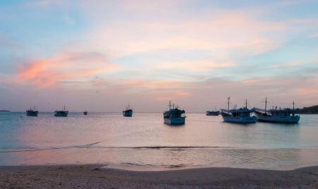 Free Bay at Island Margarita in sunset time near town Juan Griego