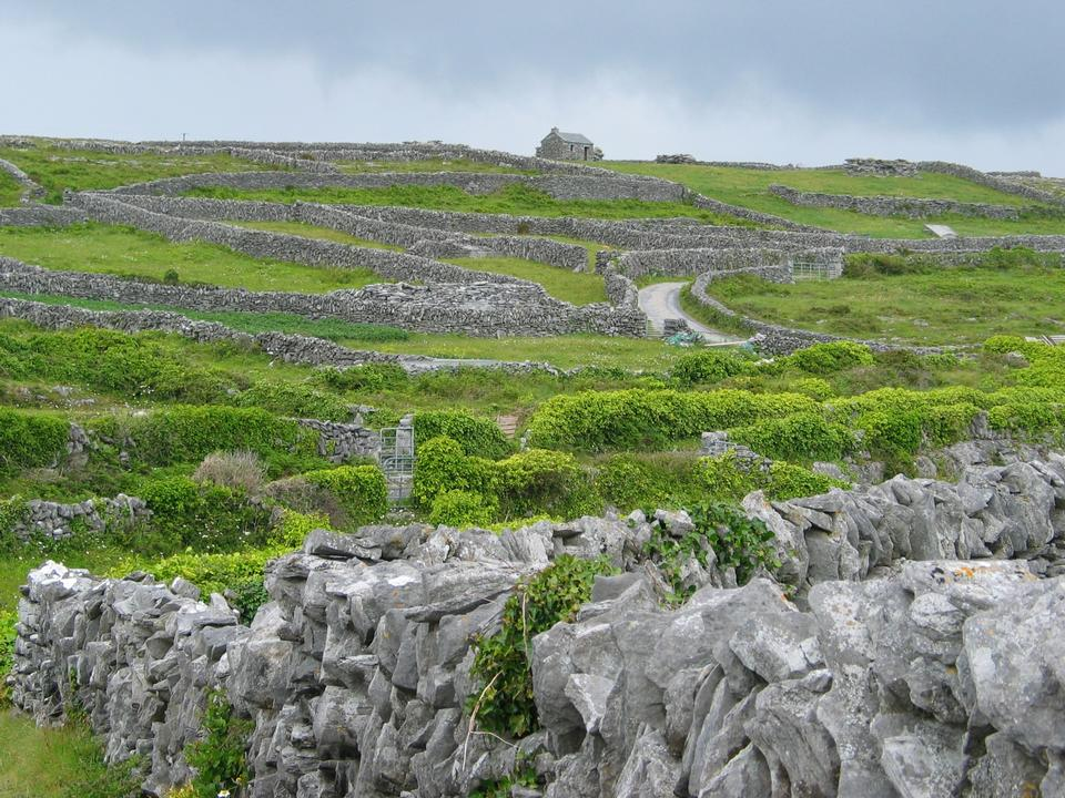 Free old stone wall fields with blue sky in the aran islands