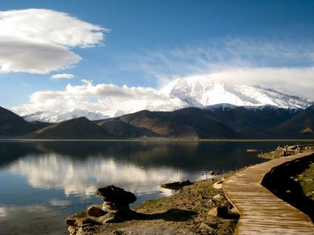 Free reflection of mountain on Karakul lake