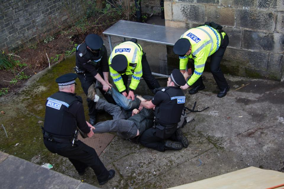 Free Police arrest an unidentified man