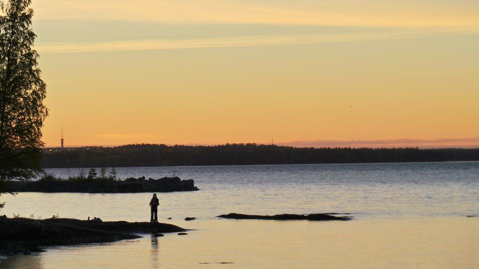 Free Fishing spinning at sunset. Silhouette of a fisherman