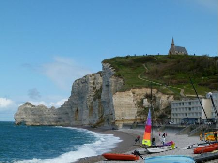 Free Sailboat on the bay beach in Etretat, France
