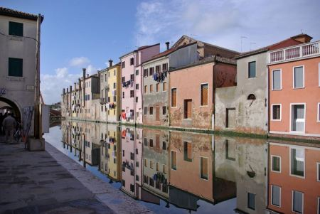 Free Chioggia Venice, typical houses along the canal with reflections