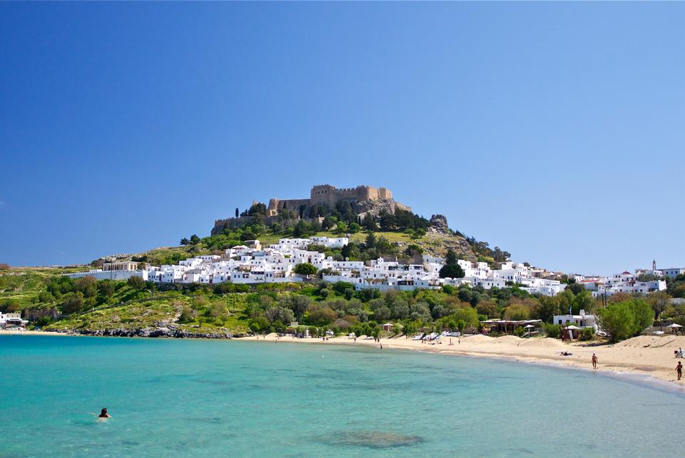 Free Lindos with the castle above on the Greek Island of Rhodes