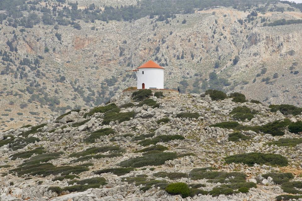 Free Traditional windmill along the rocky shoreline of Symi Island, Gr